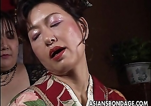 Oriental mature harlot has a rope session with respect to endure