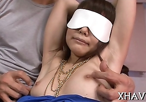 Oriental cum-hole stretched about fingers